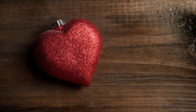 Toy heart on dark wooden background Stock Photos
