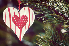 Toy heart hanging on a winter tree. toned image Royalty Free Stock Images