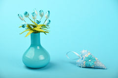 Toy heart and vase with silk tulips on blue background Stock Photo