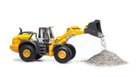 Toy heavy bulldozer. The toy heavy bulldozer of yellow color on a white background Royalty Free Stock Photos