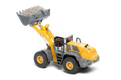 Toy heavy bulldozer. The toy heavy bulldozer of yellow color on a white background Stock Image