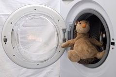 Toy Hedgehog in Washing Machine Stock Images