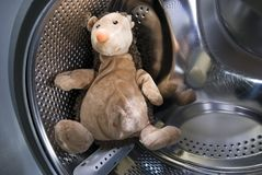 Toy Hedgehog in Washing Machine Royalty Free Stock Photography