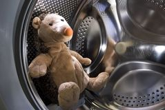 Toy Hedgehog in Washing Machine Stock Image