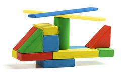 Toy helicopter, multicolor wooden blocks air transport Stock Images