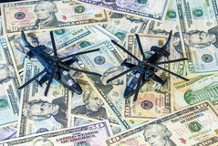 Military Helicopters landed on US currency Stock Photos