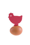 The toy hen. On the egg over white Royalty Free Stock Photo