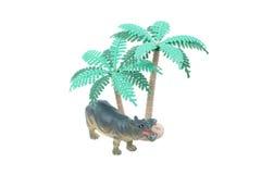 Toy Hippo con los árboles Foto de archivo