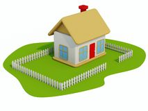 Toy-home. On grass isolated on white Royalty Free Stock Photography