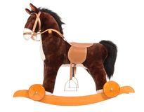 Toy horse. Brown toy horse with a saddle, a bridle and wheels Royalty Free Stock Image