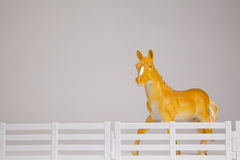 Toy Horse Behind Fence Royalty Free Stock Photos