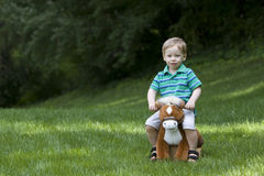 Toy horse and boy Royalty Free Stock Image