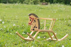 Toy horse in the field Royalty Free Stock Photos