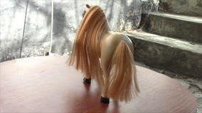 Toy horse with a magnificent tail and mane . rotating stand. stock video footage