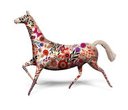 Toy horse with ornament isolated on white. Toy horse decorated with ornament Stock Images