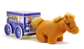 A toy horse with a wagon. A toy horse with a circus wagon over white Royalty Free Stock Photo