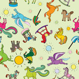 Toy horses pattern. Toy horses seamless pattern, hand drawn doodle illustrations of a series of happy baby animals over a green background Royalty Free Stock Images