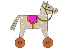 Toy horsy, skewbald on wheels. Toy little skewbald horsy with a saddle on wheels Stock Photos