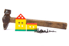 Toy house. Isolated  toy house with hammer Stock Images
