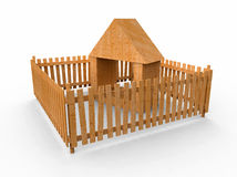 Toy house. Toy wooden small house behind a fence Stock Image