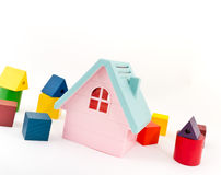 Toy house with additional bricks Stock Photo