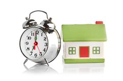 Toy House and alarm clock Royalty Free Stock Photo