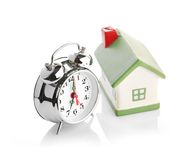 Toy House and alarm clock Royalty Free Stock Photography