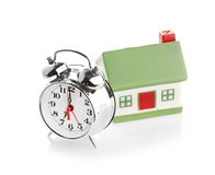 Toy House and alarm clock Royalty Free Stock Images