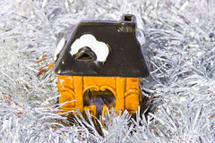 A toy house is in brilliant tinsel Stock Image