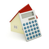 Toy house and calculator Stock Photos