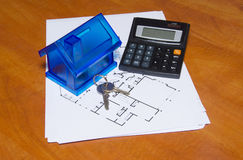 Toy house and calculator on table Stock Images