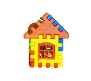 Toy house with coins Stock Images