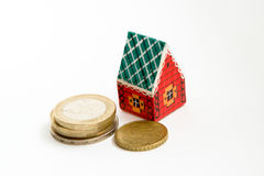 Toy house and coins Stock Images