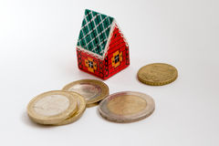 Toy house and coins Royalty Free Stock Image