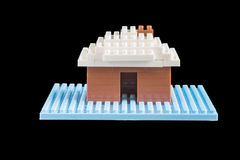 Toy house constructed of building blocks Stock Photos