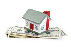 Toy house for dollar banknotes Stock Image