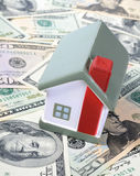 Toy house for dollar banknotes Royalty Free Stock Photography