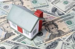 Toy house for dollar banknotes Royalty Free Stock Image