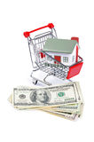 Toy house for dollar banknotes Stock Photos