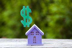 Toy house with a dollar symbol Stock Images