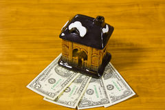 Toy house and dollars Stock Image