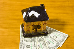Toy house and dollars Stock Images