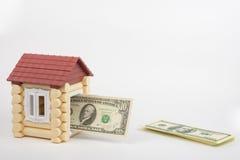 Toy house door jammed banknote of ten dollars Stock Images