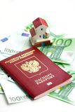 Toy house and euro banknotes isolated Stock Image