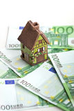 Toy house and euro banknotes isolated Royalty Free Stock Images