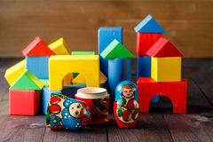 Toy house and family made of wood with blocks Stock Images
