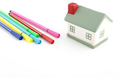 Toy house with felt pens isolated on white Royalty Free Stock Photo