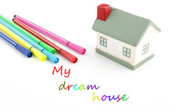 Toy house with felt pens and text isolated on white Royalty Free Stock Photo