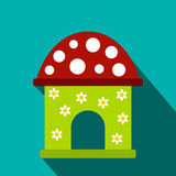 Toy house flat icon. On a blue background Stock Images