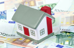 Toy House For Euro Banknotes As A Background Stock Images